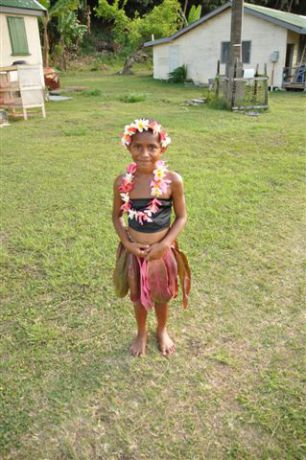 Traditional dress of a young girl readt to perform her meke. By Jane