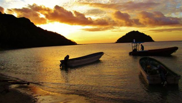 Sunset before the night dive at Makogai. By Ron